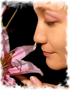 Beautiful asian woman face with pink lily flower