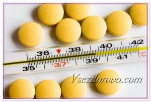 Термометр и таблетки фото