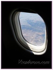 Вид из иллюминатора во время полета фото