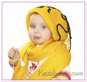Ребенок в шапке и шарфе фото